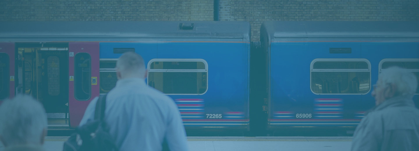 Train at platform with waiting passengers