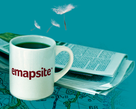 emapsite logo on mug next to newspaper