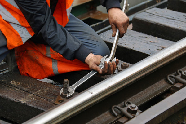 Rail track engineer carrying out track maintenance