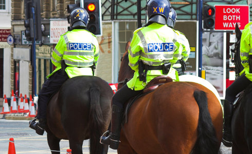 Police Officers on horses in urban environment